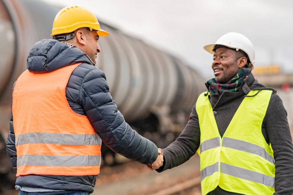 construction professionals shaking hands on the job
